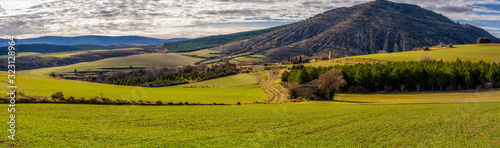 Obraz panorama of green meadows and uninhabited villages in the highlands, spain - fototapety do salonu