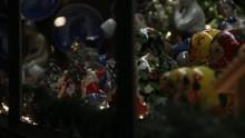 Christmas Display In Window Pan To Teen Admiring It