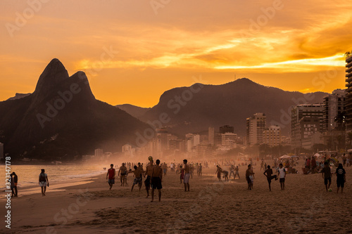 Playing keepy uppy (altinho) with football on Ipanema beach at sunset with Dois Tablou Canvas