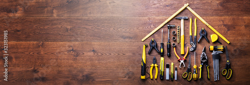 Obraz House Made Up Of Measuring Tapes And Tools - fototapety do salonu