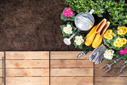 Photo Gardening Tools And Flowerpots In Garden