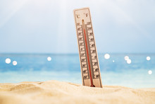 Thermometer On Sand Showing High Temperature