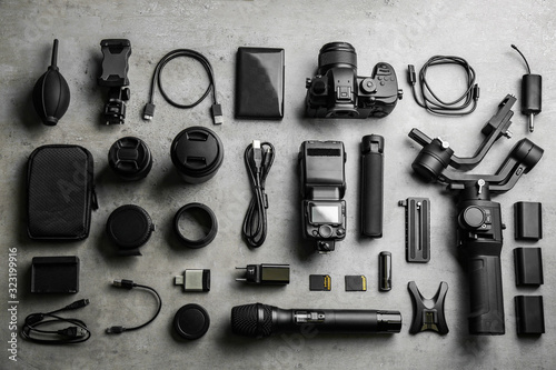 Flat lay composition with camera and video production equipment on light grey st Canvas Print