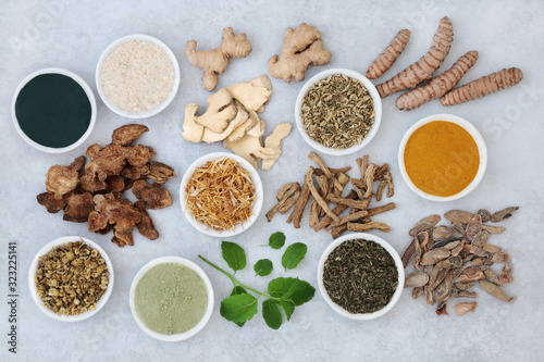 Valokuvatapetti Herbs and spices used in chinese herbal medicine to treat irritable bowel syndrome with dietary supplement powders