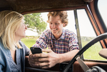 Young Guy Talking To Girl And Asking For Phone Number In Old Jeep. Bridger, Montana, USA