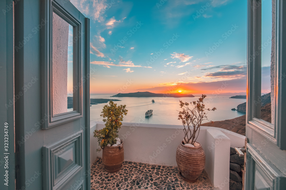 Fototapeta Amazing evening view of Santorini island. Picturesque spring sunset on the famous Greek resort Fira, Greece, Europe. Traveling concept background. Artistic style post processed photo. Summer vacation
