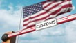 Closing boom barrier with CUSTOMS sign against the American flag. Border closure or protective tariffs in the USA