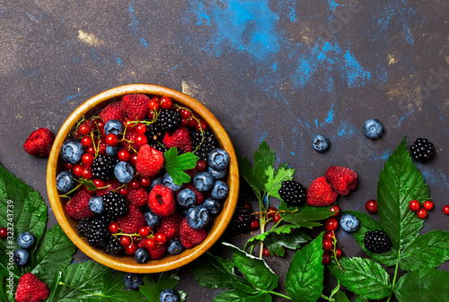 Fototapeta Summer berries in assortment, food background, top view copy space obraz