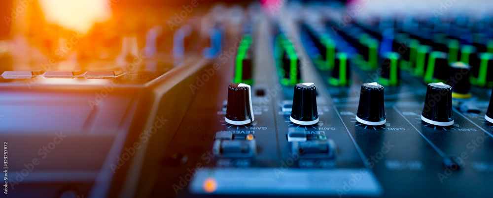 Fototapeta ็Music mix studio concept, hand control mixing sound console for good sound in concert, professional technology for musician engineer, board and buttons control for working on blurred background