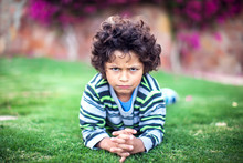 A Portrait Of Sad Kid Boy Outdoor. Children And Emotions Concept