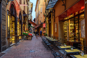 Old narrow street in Bologna, Emilia Romagna, Italy. Architecture and landmark of Bologna. Cozy cityscape of Bologna.