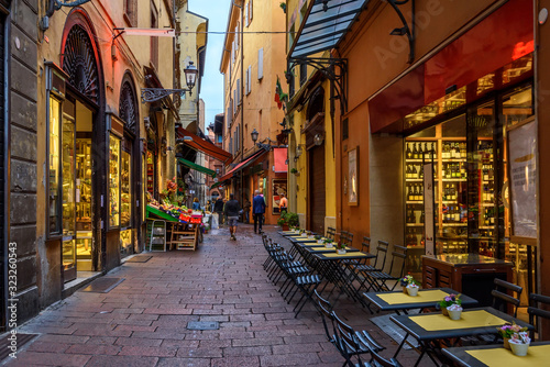 Fototapeta Old narrow street in Bologna, Emilia Romagna, Italy. Architecture and landmark of Bologna. Cozy cityscape of Bologna. obraz