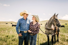 Western Couple With Their Hors...
