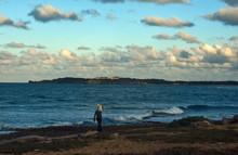 A Fisherman Walks Along A Wild Beach On The Atlantic Ocean Coast. Dominican Republic