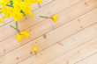spring background decoration with Easter bells, daffodils flowers on wooden floor in old building. spring decoration or easter decoration. Naturally designing Naturally designing sustainable