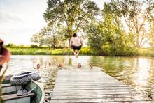 Group Of Young Adults Having Fun In A Swimming Lake. Bridger, Montana, USA