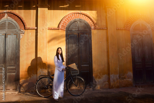 Beautiful  woman with Vietnam culture traditional ,vintage style,Hoi an Vietnam Fototapete