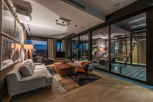 Interior Of A Living Room In A Luxury Penthouse Apartment In The Evening