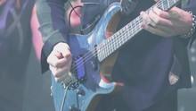A Virtuoso Guitarist Playing A...