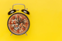 Black Alarm Clock With A Pizza...