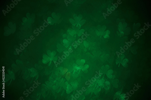 Fototapeta Clover shaped bokeh. St.Patrick 's Day. Blurred abstract background. Green shamrock obraz