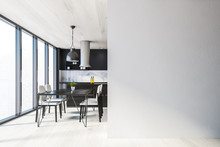 Black Kitchen With Table And M...