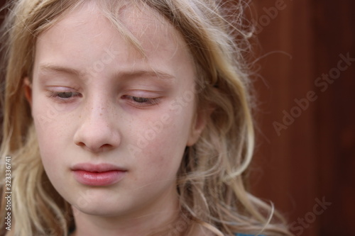 Portrait of a beautiful blonde girl with her eyes averted Wallpaper Mural