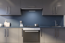 Blue Kitchen With Gray Counter...