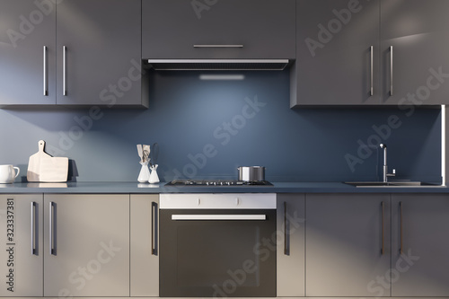 Blue kitchen with gray countertops