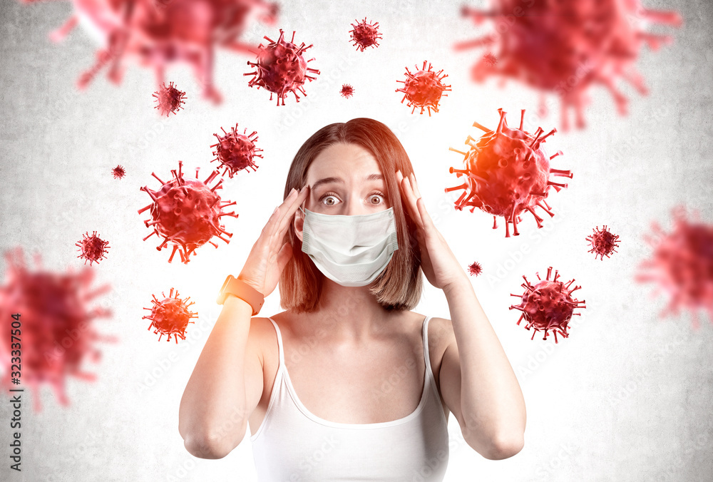Fototapeta Scared young girl in mask, coronavirus panic