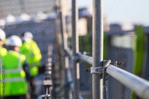 Obraz na płótnie Construction workers on a scaffold