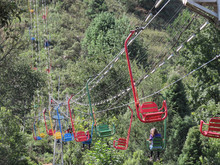 Several Chairlift Chairs In Various Colors