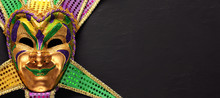 Colorful Mardi Gras Mask Backg...