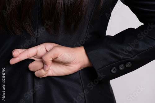 Close up businesswoman with her fingers crossed behind her back - concept for good luck or dishonesty business Tapéta, Fotótapéta