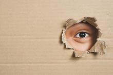 Boy Eye Peeking Through A Hole...