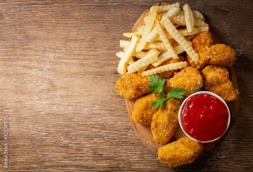 Fototapeta fried chicken and french fries, top view obraz