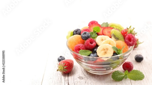 Fototapeta fruit salad with melon, strawberry, banana, kiwi and blueberry obraz