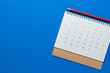 canvas print picture - close up of calendar on the blue table, planning for business meeting or travel planning concept