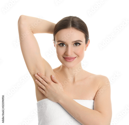 Young beautiful woman showing armpit with smooth clean skin on white background Wallpaper Mural