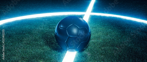 Fotografía Soccer ball on glowing lines on a field at night