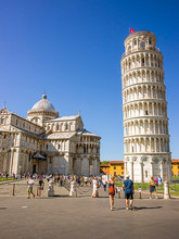 Pisa Leaning Bell Tower And Cathedral In Italy In Summer