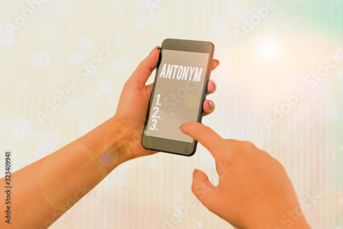 Photo Conceptual hand writing showing Antonym