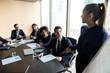 Confident businesswoman lead flip charts presentation new project in boardroom.