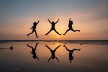 Silhouette Of Three Girls Jump...