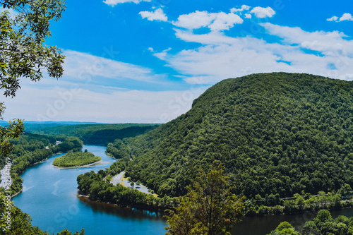 Fotografia, Obraz A Vibrant Mountain Landscape and Skyline with a River Running Through