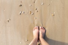 Girl Foot On Sand Beach With S...