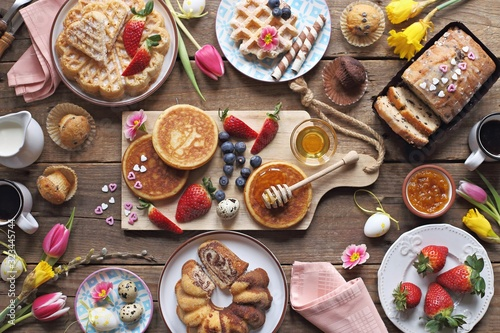 Fototapeta Easter festive dessert table with various of cakes,  pancakes, waffles and sweets. obraz