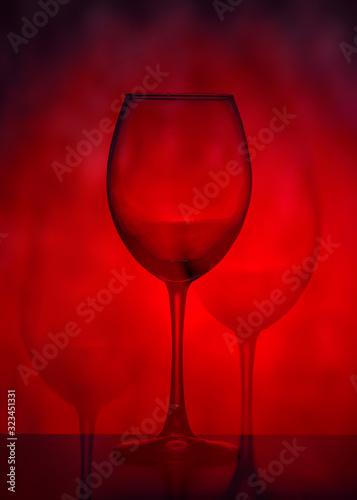 Valokuvatapetti Wine glasses on a red background
