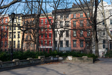Tompkins Square Park In The East Village Of New York City With Colorful Buildings In The Background