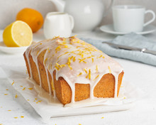 Lemon Bread Coated With Sugar Sweet. Cake With Citrus, Whole Loaf, Side View, Close Up, Vertical